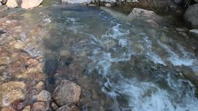 The stream flows through the valley. Are turbulent and clear. Very beautiful scenery stock video