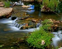 Stream through Forest Park. Water flowing over rock outcrops in Forest Park in St. Louis, Missouri Royalty Free Stock Photos
