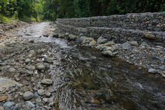 Stream with gabion wall Stock Photos