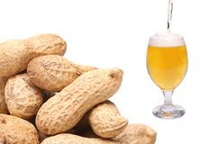 Stream, glass of beer and peanuts Royalty Free Stock Photo