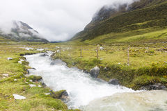 A stream high in the mountains on the Salkantay trail. At Cuzco, Peru Royalty Free Stock Images