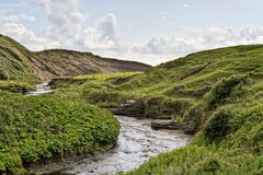 Stream in Ireland. A stream in rolling hills of Ireland Royalty Free Stock Images