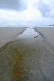 Stream leading to the ocean on long Beach tofino Royalty Free Stock Photo