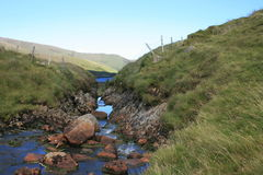 Stream in Mayo. River bed and bank, Co. Mayo, Ireland Royalty Free Stock Images