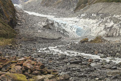 Stream from the melting of fox glacier Stock Image
