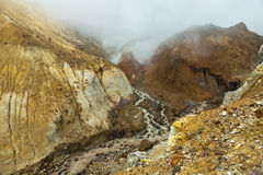 Stream from melting of glaciers on the active volcano Mutnovsky. Royalty Free Stock Image