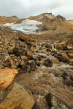 Stream from melting of glaciers on the active volcano Mutnovsky. Royalty Free Stock Photo