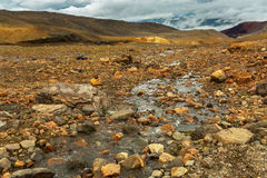 Stream from melting of glaciers on the active volcano Mutnovsky. Stock Images