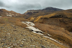 Stream from melting of glaciers on the active volcano Mutnovsky. Royalty Free Stock Images