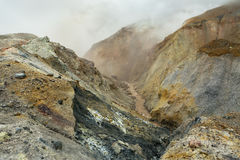 Stream from melting of glaciers on the active volcano Mutnovsky. Royalty Free Stock Photography