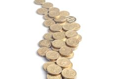 Stream of Money. A stream or river of golden-colored one pound English coins Stock Images