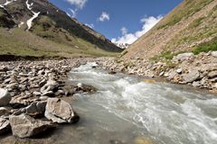 Stream of mountain river. Caucasus valley. Royalty Free Stock Image