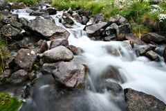 Stream of mountain river among stones and boulders Stock Photography