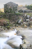 Stream and old mill. Ruin royalty free stock images