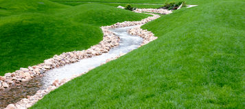 A stream and park. A river running throuh a park royalty free stock image