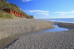 Stream on the pebble beach. In village of Branscombe, Devon part of Jurassic Coast World Heritage Site stock images