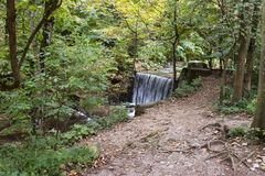 The stream Pelesului in the garden of Peles castle in Sinaia, in Romania royalty free stock photo