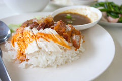 Stream rice with mixed chicken and pork. Thai food gourmet stream rice with mixed chicken and red pork Royalty Free Stock Photos