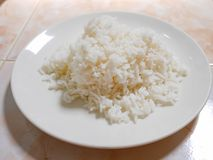 Stream rice. In the white plate on the table Royalty Free Stock Images