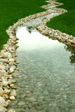 Stream and river of perspective. A river winding down a man made path Royalty Free Stock Photo