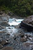A stream with rocks at Falls Creek on the Milford Sound Highway in Fiordland in New Zealand royalty free stock photo