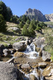 Stream between rocks in the middle of the mountains in Pyrenees Stock Image