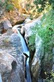 River stream in Kalavrita Greece. Stream among rocks in the path Kalavrita- Diakopto in Greece Stock Photos