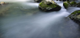 Stream and rocks. Water flowing over rocks in a small stream in the lover gorge. in Guizhou Province, China Royalty Free Stock Photos