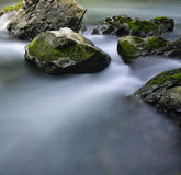 Stream and rocks. Water flowing over rocks in a small stream in the lover gorge. in Guizhou Province, China Stock Images