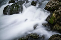 Stream and rocks. Water flowing over rocks in a small stream in the lover gorge. in Guizhou Province, China Royalty Free Stock Photography