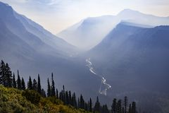 Stream through a misty mountain valley in Montana. royalty free stock images