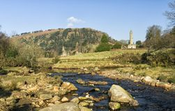 Glendalough Round Tower and Rocky Stream. Stream running by the monastic site of Glendalough in the Wicklow Mountains on Ireland`s ancient east coast Stock Image