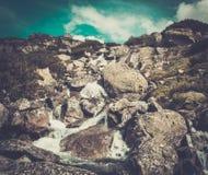 Stream running through rocks Stock Image