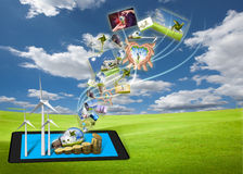 Stream of saving energy images from tablet pc Royalty Free Stock Photos
