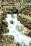 Stream. A small stream that feeds an old mill still working in Tuscany, Italy Royalty Free Stock Photography