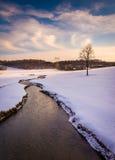 Stream through a snow covered farm field in rural Carroll County Royalty Free Stock Photos
