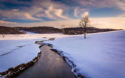 Stream through a snow covered farm field in rural Carroll County Royalty Free Stock Photo