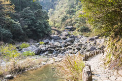 Stream and stone arch bridge. This photo was taken in Longwan Lake National Forest Park, Nanxi River Scenic Area, Yongjia county,Zhejiang province,china Stock Photography