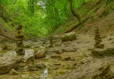 Stream and a stone tower in a forest royalty free stock photo