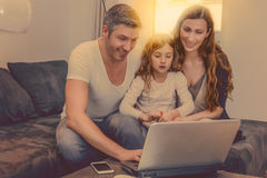 Stream technology at home. Family on couch at home watching online tv shows Royalty Free Stock Images