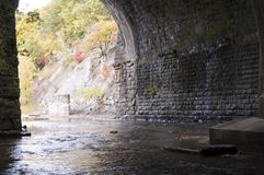 Stream Tunnel under Train Bridge Stock Image