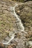 Stream in the vent of the ancient volcano girvas royalty free stock photo