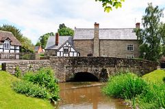 Stream and village buildings, Eardisland. Stock Photography