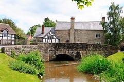 Stream and village buildings, Eardisland. Stock Photography