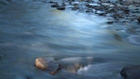 Stream washing over rocks timelapse stock footage
