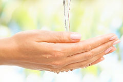 Stream of water with beautiful female hands Royalty Free Stock Photography