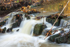 Stream of water flowing through stones, long exposure Royalty Free Stock Images