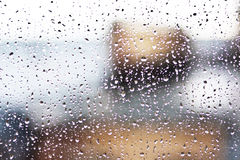 Stream of water in heavy rain. Raindrops on window pane. Blur effect Royalty Free Stock Photo