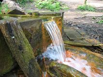 Stream of water. On an old curative source, Ukraine Stock Image