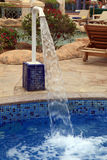 Stream of water in outdoor resort pool Royalty Free Stock Image